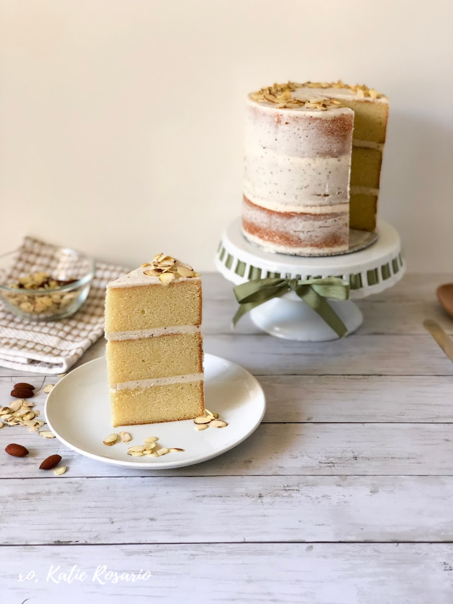 """Fall is here, and this brown butter almond cake is the perfect way to introduce the new season! When it comes to decorating this cake seriously, anyone can make it. This decorating style is typically called a crumb coat or a """"naked"""" cake. This method means that it's a light layer of buttercream covering the sides of the cake. Learn how to make this brown butter almond naked cake! #xokatierosario #cakedecoratingtipsandtricks #nakedcakeideas #brownbutteralmondcake #almondcakerecipes"""