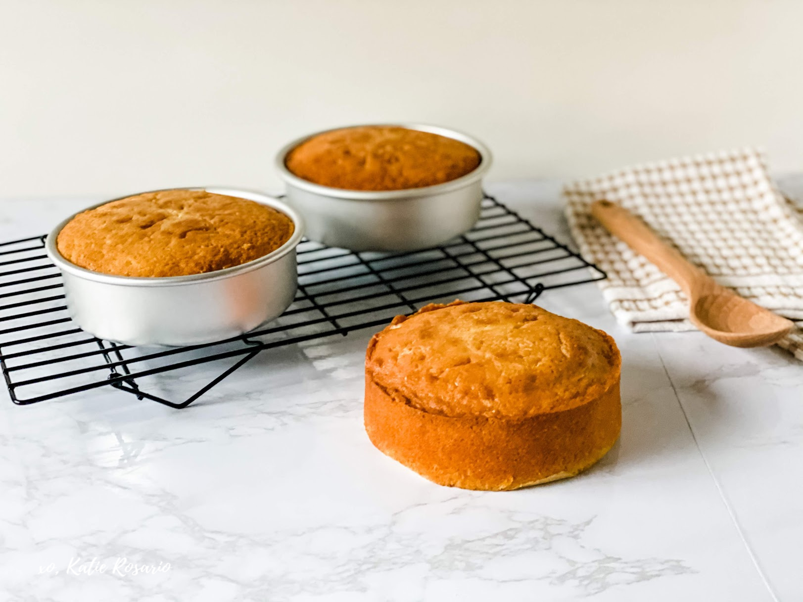 For beginner bakers, it can be intimidating to make your first cake from scratch. This vanilla cake recipe is perfect for the beginner home baker. My goal is to teach you foundation steps so you feel like you can make any cake, even vanilla. You can use this vanilla cake recipe for cupcakes or turn into a sheet cake for a larger crowd. #xokatierosario #cakedecoratingtips #vanillacake #madefromscratch #vanillacakerecipe
