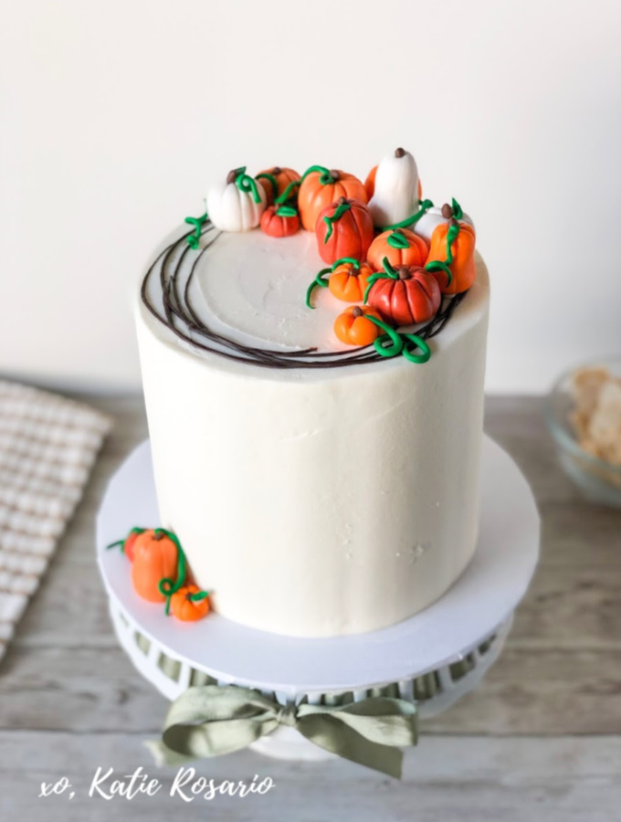Learn how to make these Thanksgiving Inspired Cakes for a happy holiday. You'll find Thanksgiving inspired cakes like a pumpkin spice Turkey Cake, Caramel Apple Cake, Autumn Painted Buttercream Cake and a clever Pumpkin Patch Cakes that's edible art. The best part about these cakes is that they not only look like a show stopping centerpiece but they are freaking delicious! #xokatierosario #Thanksgivingcakeideas #fallcakes #cakedecoratingtips #cakedecoratingforbeginners