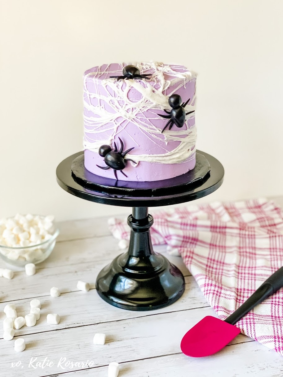 Halloween is an excellent time of year to experiment and step out of your comfort zone while baking and decorating cakes. Celebrate Halloween this year with this creepy crawly Spider Web Cake. Learn how to make this surprisingly simple Spider Web Cake! Halloween Spider Web Cake for Beginners Bakers #xokatierosario #katierosario #cakedecoratingtips #halloweencakeideas #spidercake