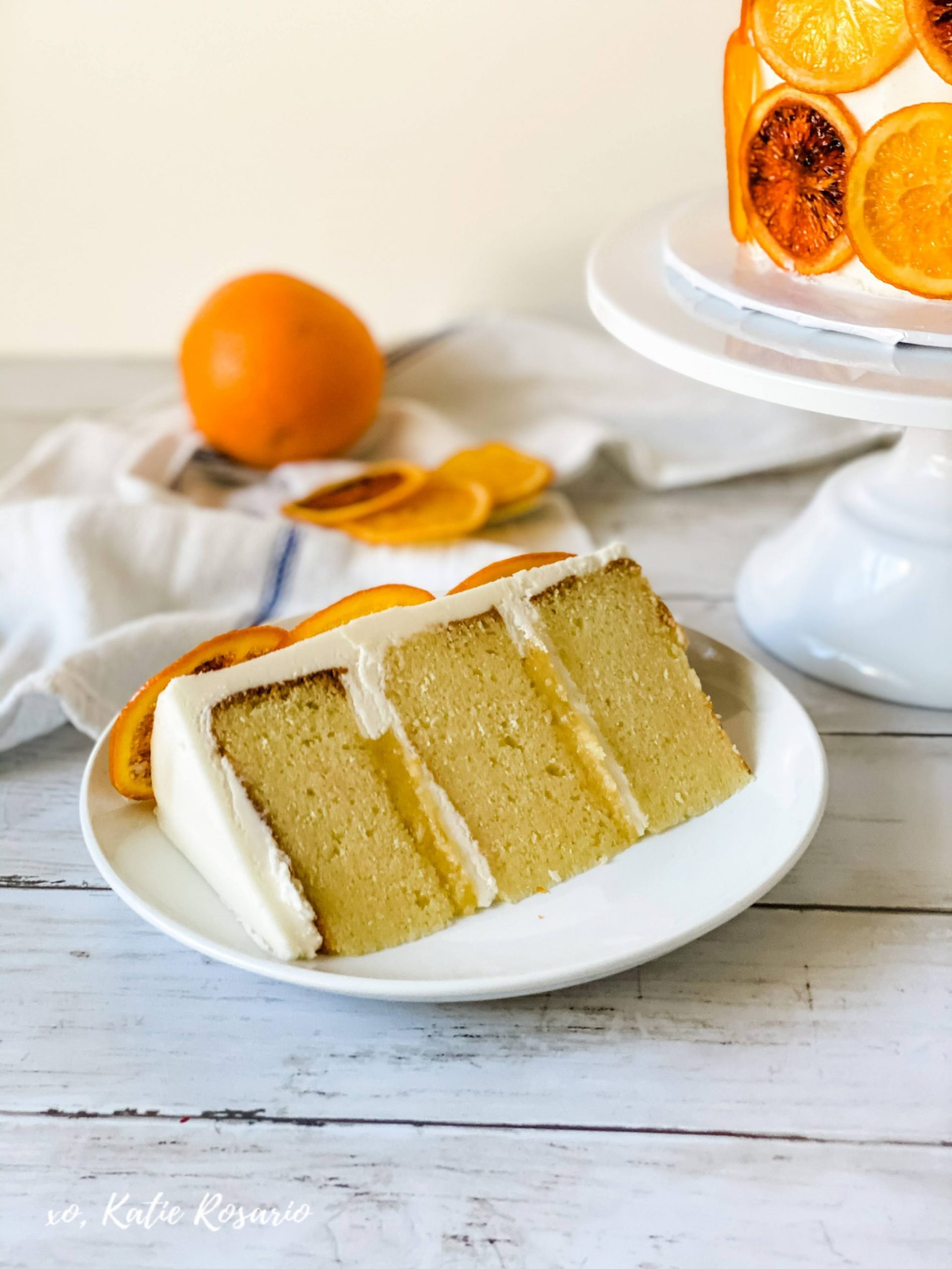 Looking to make something tasty with all that citrus? This Winter Citrus Cake is full of flavor, and something everyone will love to eat. This Winter Citrus cake is made with almond orange cake, grapefruit curd, navel orange buttercream, and homemade candied blood oranges. I'll show you how to make all these different citrus flavors incredible in this Winter Citrus Cake. #xokatierosario #katierosariocake #wintercakeideas #citruscake #cakedecoratingtips