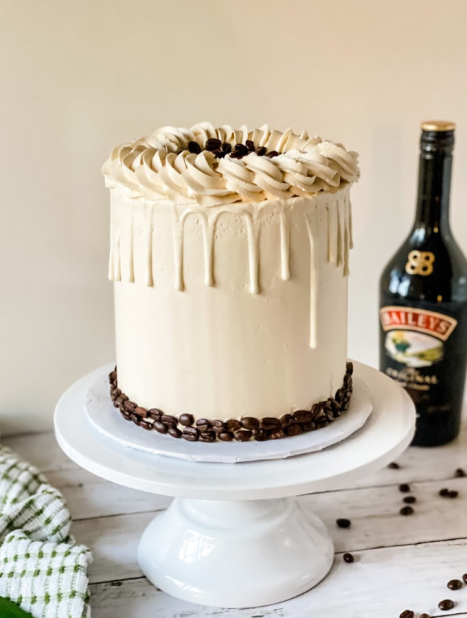 Learn how to make this Irish Cream Cake that is ready for any celebration! This cake is perfect for Bailey's Irish Cream lovers, and there is Irish Cream in every part of this cake. Yes, it's a little boozy, but the sweet coffee's flavor stands out the most; it's rich and creamy! Sweet & Simple Irish Cream Cake with Swiss Meringue Buttercream #xokatierosario #katierosariocakes #irishcreamcake #irishcream #stpatricksdaycake #cakedecoratingtips