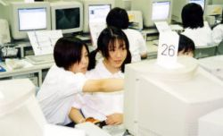 Japanese Schoolgirls at the Computer