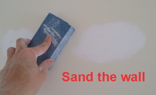 Sand the wall