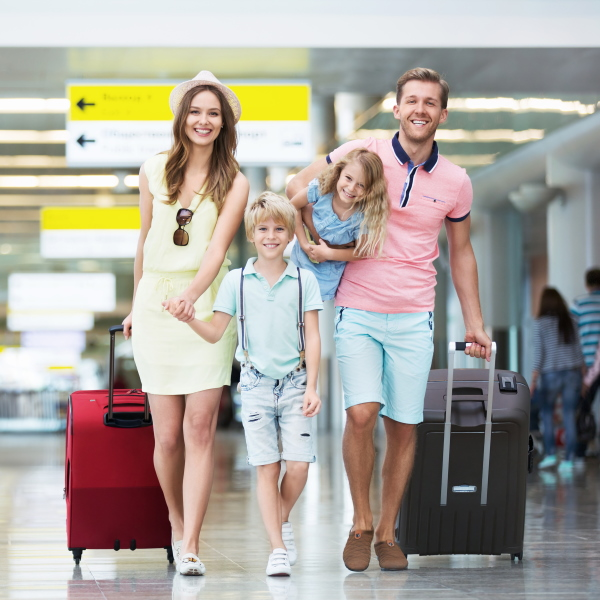 Family walking around Bristol airport after an airport taxi journey