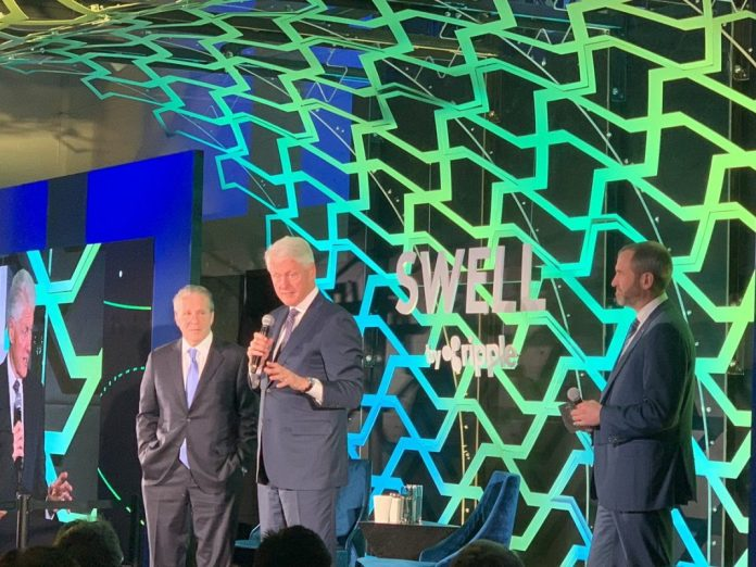 Ripple's Swell conference 2018 xRapid being used, Bill Clinton and Brad Garlinghouse on stage.