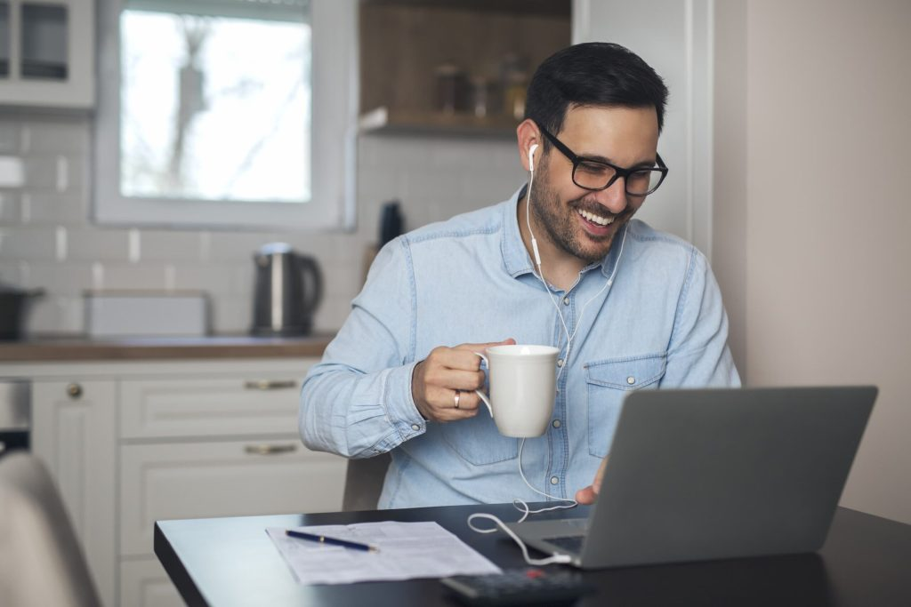 Man having video call on laptop