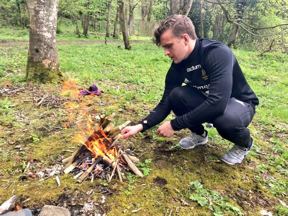 A delegate of Orangeworks bushcraft zone activities learning how to start an outdoor fire.
