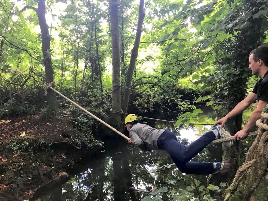 A delegate of Orangeworks activity, Bushcraft Zone, learning how to do to a tyrolean water crossing at Carton House.