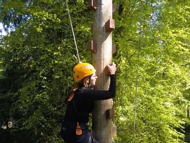 A child learning how to do a tree climb at Xtreme's Adventure Summer Camp at Carton House Maynooth.