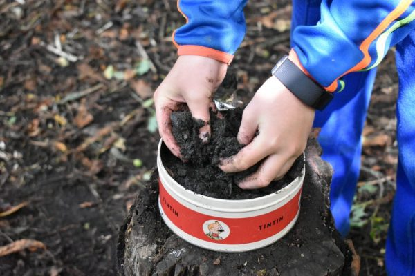 """A boy playing in the """"Mud Kitchen"""" at Xtreme.ie's Bushcraft birthday party at our private forest in Carton House."""