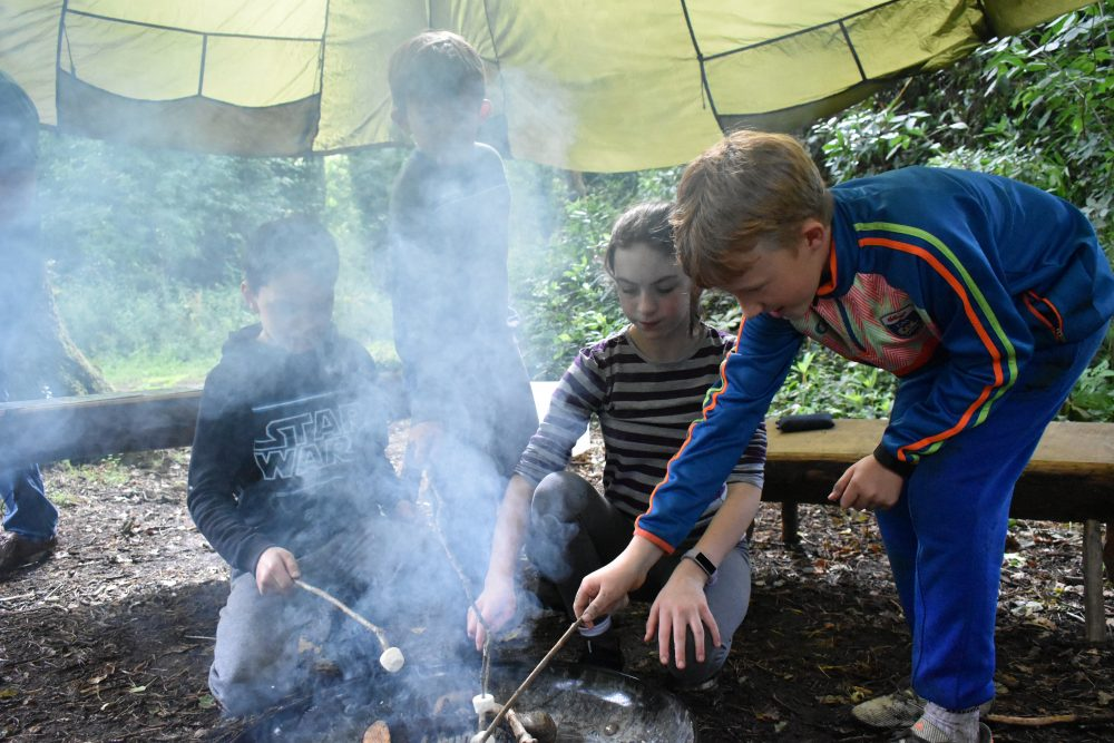 Children at Xtreme.ie's Midterm Camp at Carton House lighting fires and toasting marshmallows.