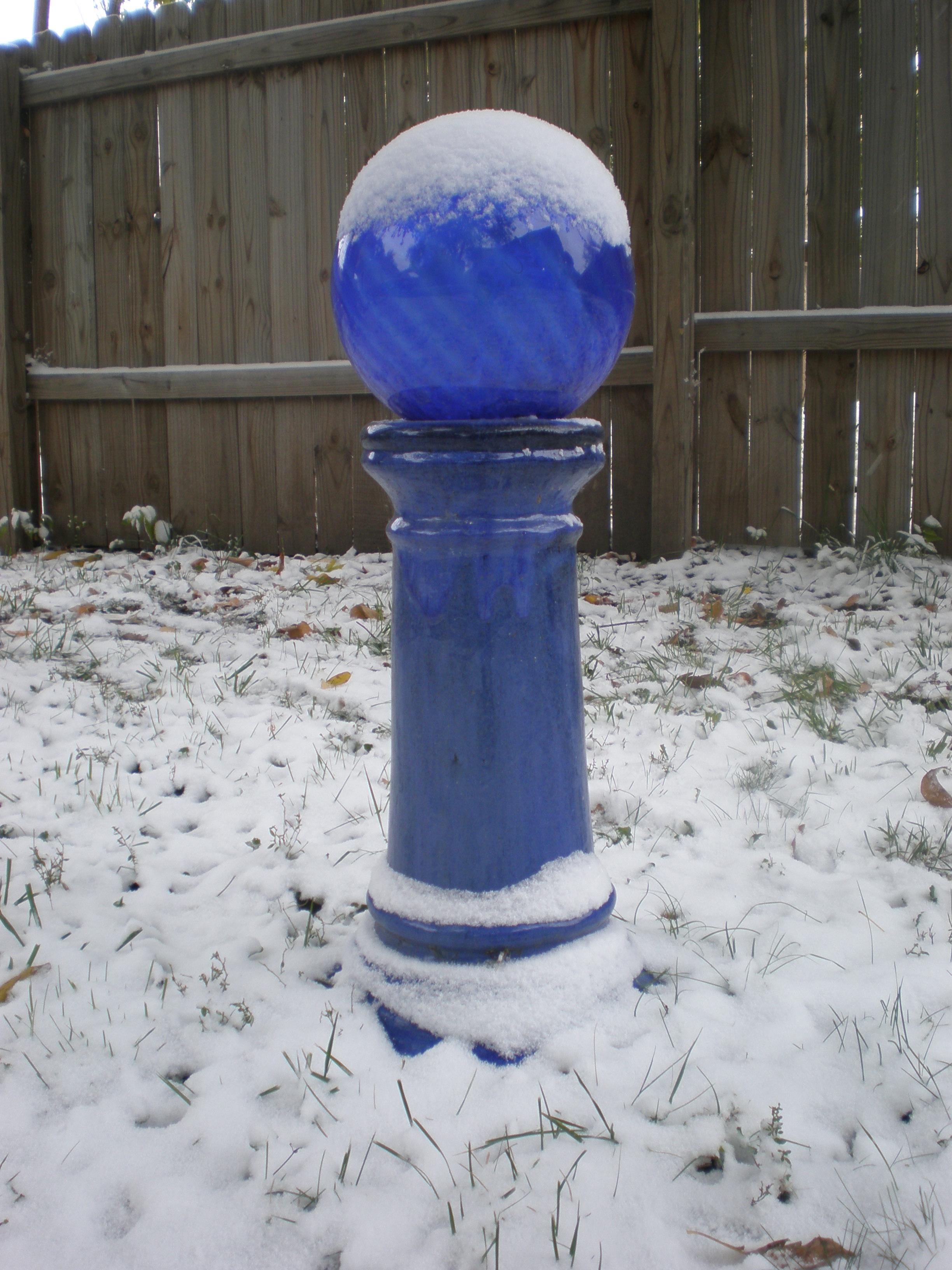 garden ball in snow