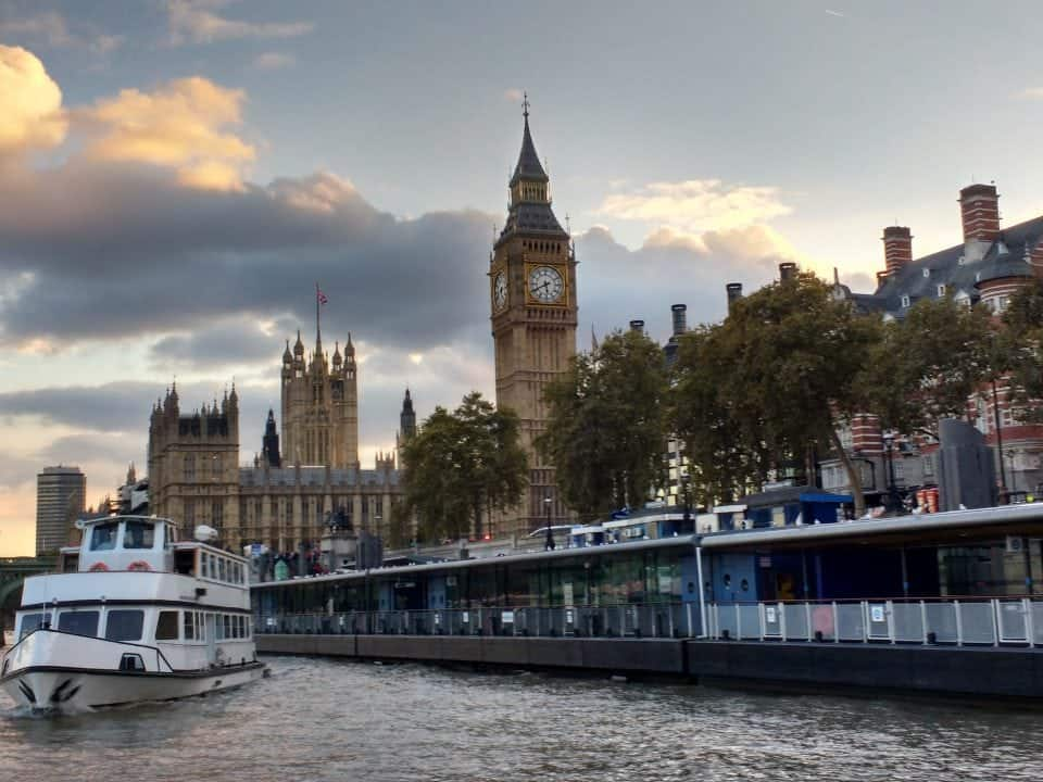 a river cruise view of Big Ben and the Houes of parliament