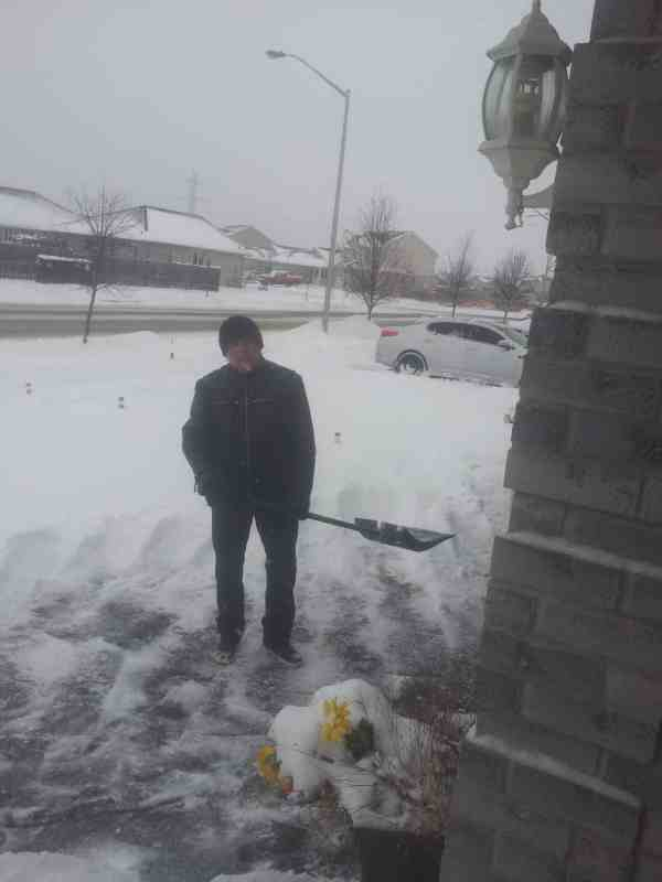 Boomer travelers and expat wannabes - the reasons are clear here is Alan shoveling snow in a cold and miserable Canada