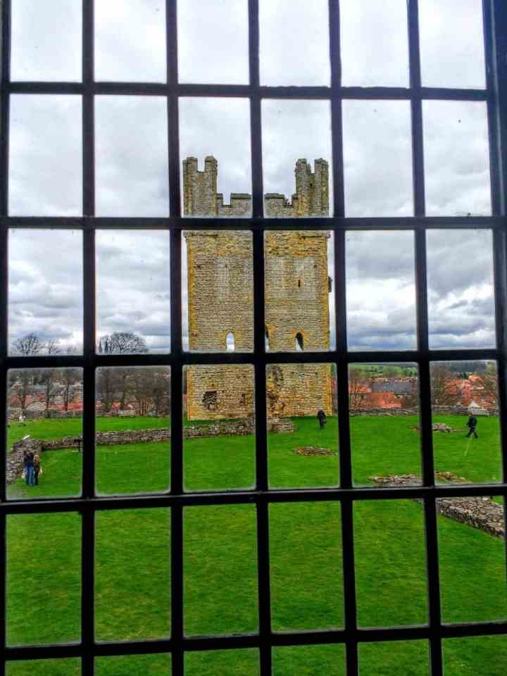 a ruined castle in the market town of Helmsley North Yorkshire - Helmsley castle a view of the tower from a window