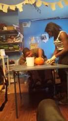 Xzavier Davis-Bilbo and sister Aurie Parris carve a pumpkin for Halloween 2013