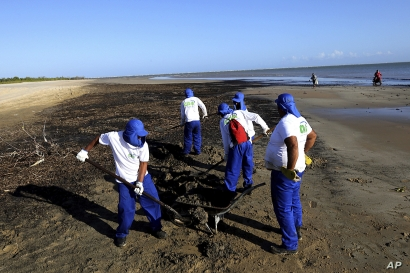 CORRECTS DATE - In this Oct. 8, 2019 handout photo released by the Aracaju Municipal Press Office, workers remove oil from…