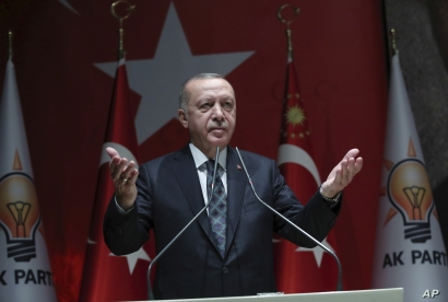 Turkey's President Recep Tayyip Erdogan speaks to his ruling party officials, in Ankara, Turkey, Thursday, Oct. 10, 2019…