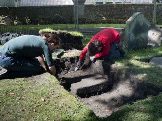 Alexander and Naomi uncovered a tiny gravestone in an enormous trench
