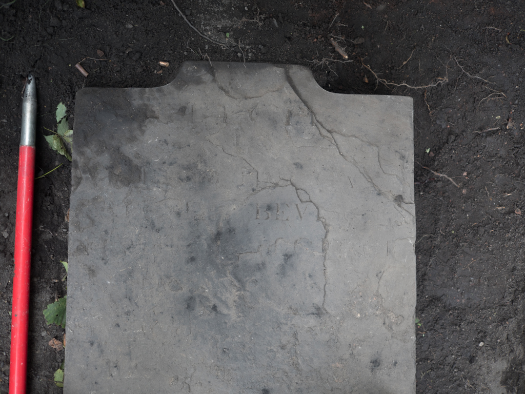 Fragments of inscription on the headstone