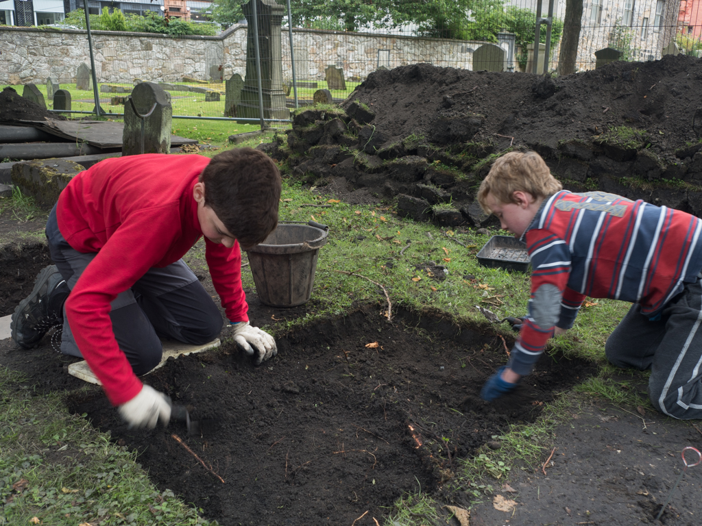 Alexander and Daniel get started excavating a new test pit