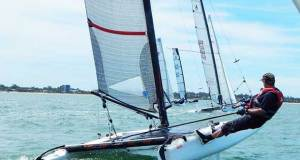A class catamaran fleet action at Humpybong Yacht Club - Queensland A Class Catamaran Championships Humpybong Yacht Club