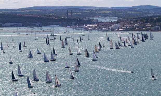 The 47th Rolex Fastnet Race gets underway from the Royal Yacht Squadron line, Cowes, Isle of Wight UK © Rolex / Carlo Borlenghi http://www.carloborlenghi.net