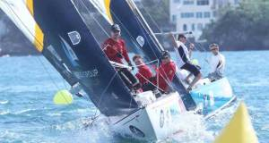 Swedish skipper Johnie Berntsson (right, in red shirt with cap) works hard to clear a windward mark during the 2015 Argo Group Gold Cup © Charles Anderson / RBYC