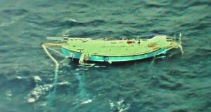 Abhilash Tomy's dismasted yacht Thuriya, photographed from an Indian military plane early today - photo © Indian Navy / PPL / GGR