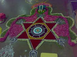 Vedic Star drawn as alpana in front of Indian house.jpg