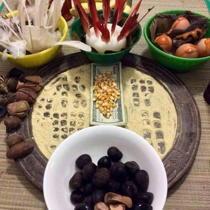 Tray set up for sacrifice (Ebo) where Iyerosun is applied