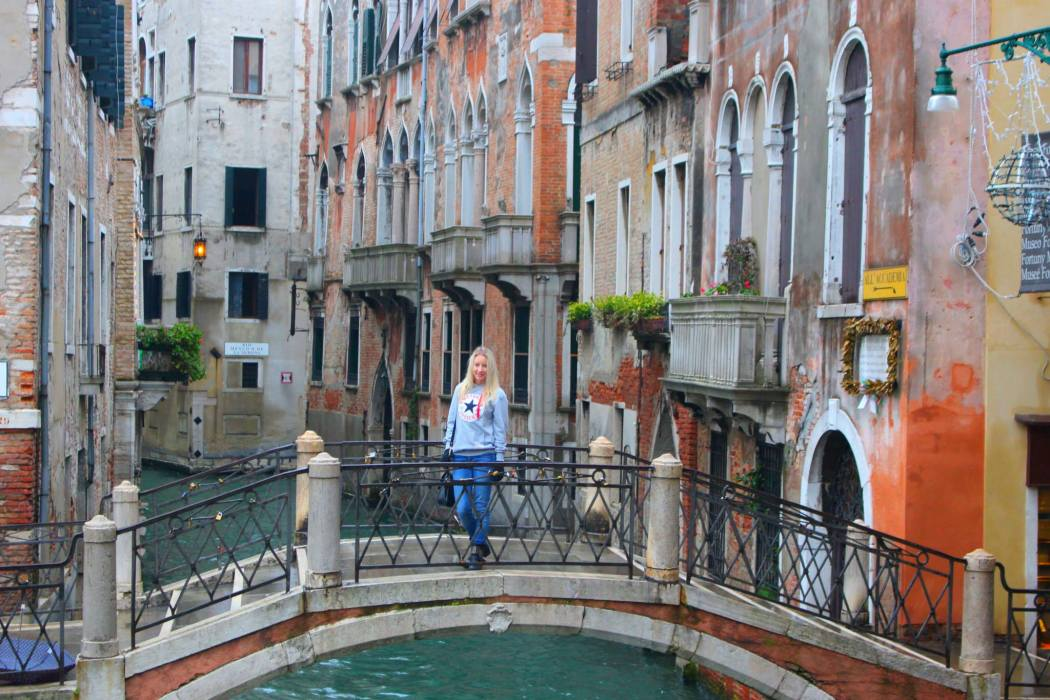 Amy  on a bridge over a canal in Venice, Italy
