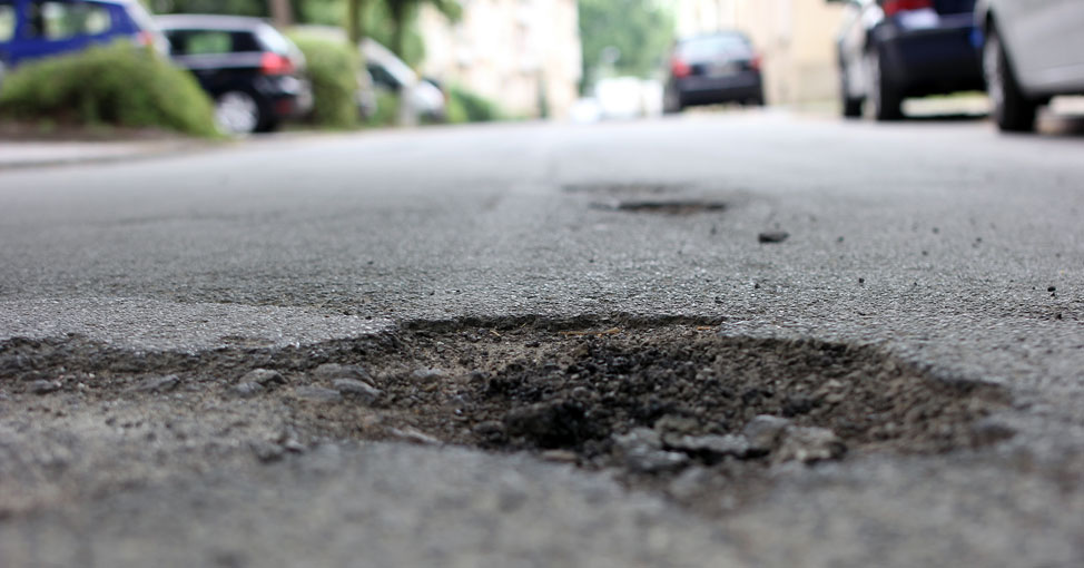 Road with pothole