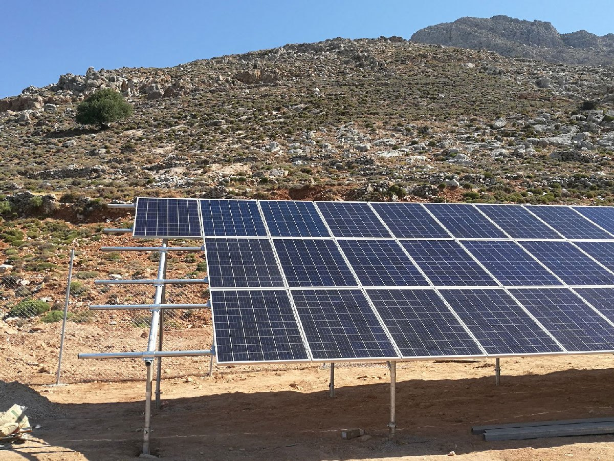 Solar panels in front of a desert-like hill