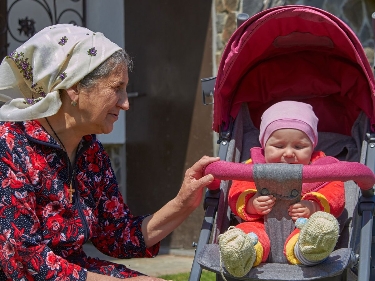 Elderly woman and baby