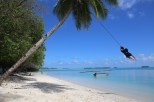 Swinging from a coconut tree in Funafala