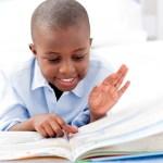 Small boy reading a book