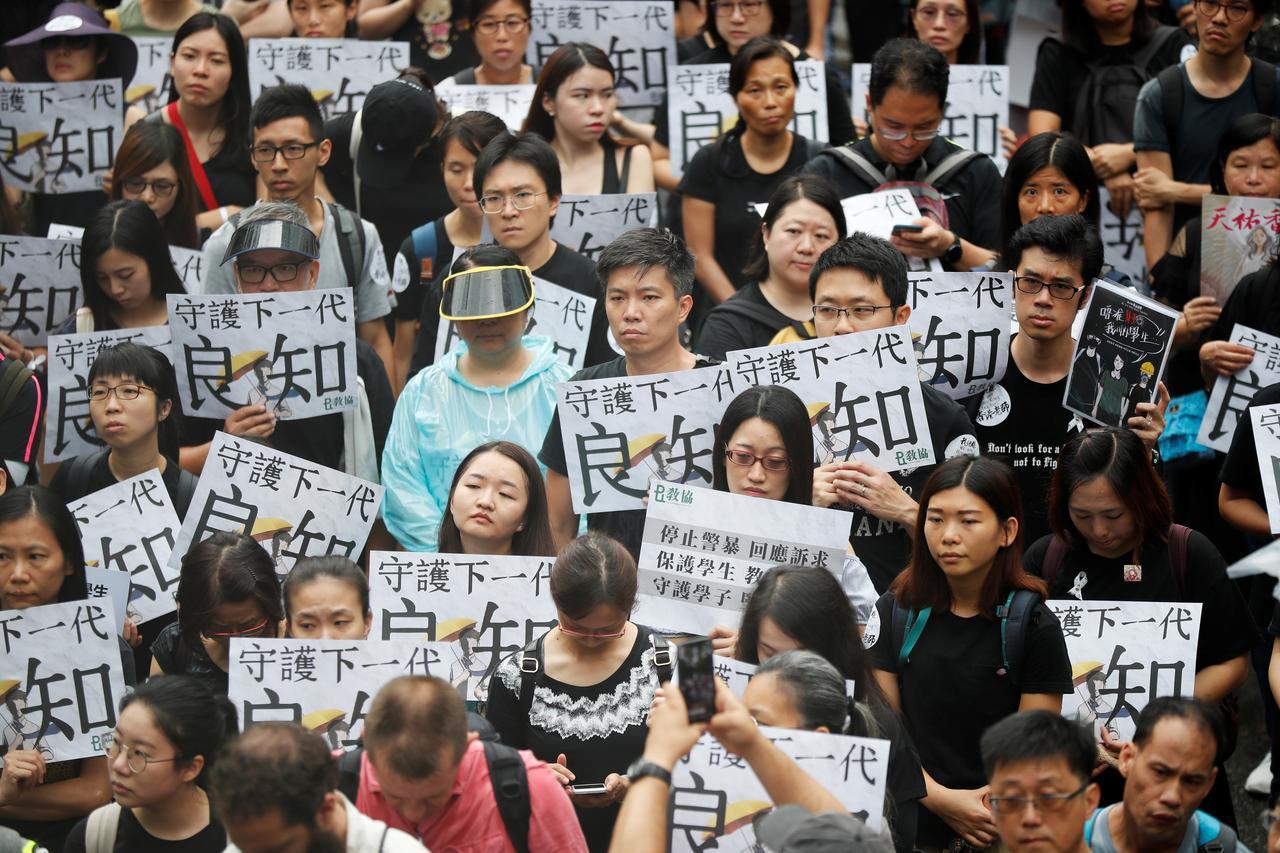 Hong Kong teachers join students to launch fresh weekend of protests – Ya Libnan