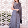 Hand embroidered Yoke in Zari and Katdana work, this Draped Gown has a mini Dupatta attached to the shoulder and the waist. The Draped Gown has 3 pleats added to its waistline