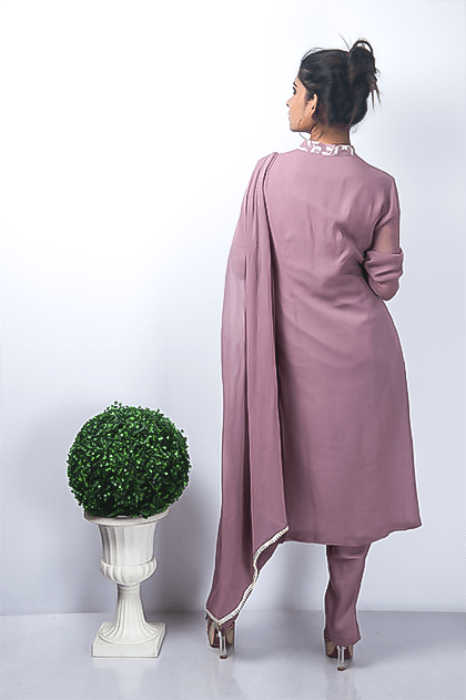 The front of the straight kurta has Chikankari embroidery with sequins detailing on it. The back is plain. It is paired with a Georgette Dupatta that is hemmed with Pearl Lace