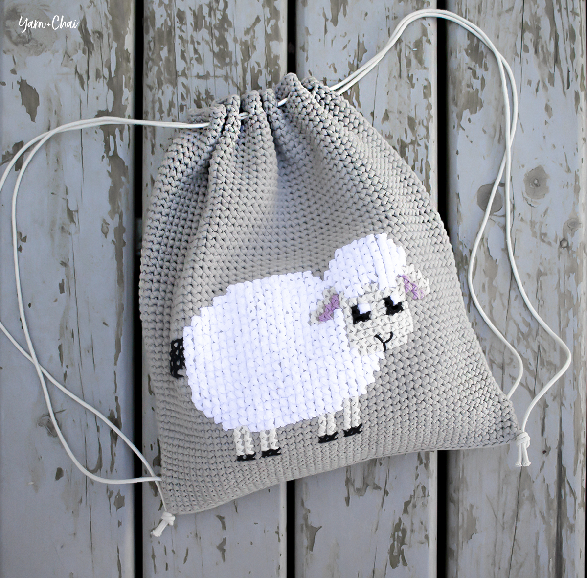 Cross-stitched Lamb Cinched Backpack