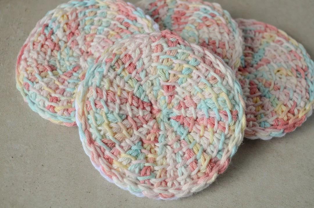 Tunisian crochet face scrubbies in a pile