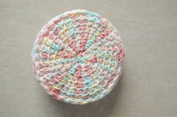 Front view of a Tunisian crochet face scrubby