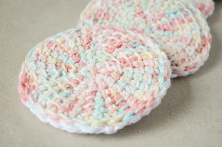 Tunisian crochet face scrubbies on top of one another