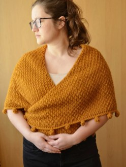 One way of wearing a Tunisian crochet shawl - around the shoulders and tied at the back