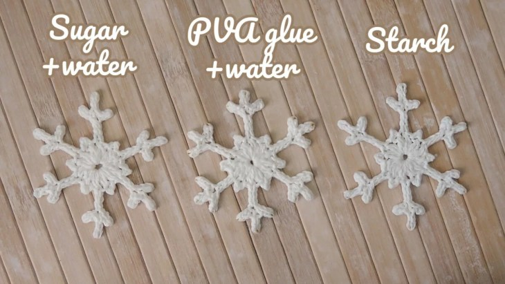 Three snowflakes, one stiffened with sugar, one with PVA glue, one with starch