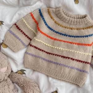 PetiteKnit - pk123_festival_sweater_baby_1