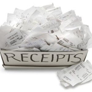 throwing receipts in a box