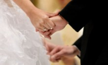 Image of a couple holding hands at a wedding at Yass Valley Anglican Church